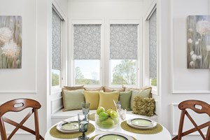 Roller Shades with Smart Pull Lift and a stylish floral print accent a dining room